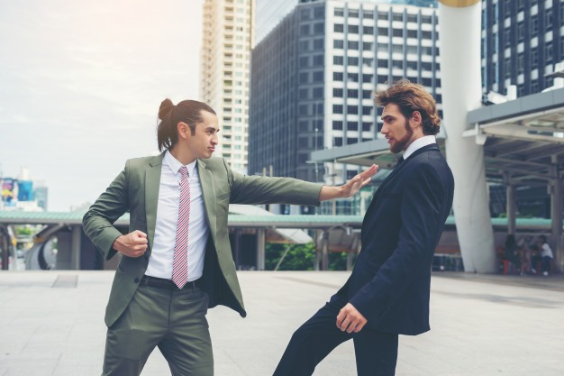 two-businessmen-mad-each-other-trying-to-come-to-an-agreement_1150-2620